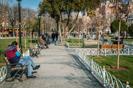 aya sofia: Istanbul, Turkey - January 31, 2016: Tourists are visiting Sultan Ahmet area and shooting funny photos in Istanbul, Turkey