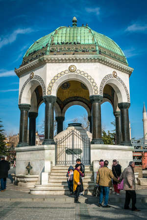 constantinople ancient: Istanbul, Turkey - January 31, 2016: Tourists are passing by German Fountain in Sultan Ahmet Square, the ancient Hippodrome of Constantinople Editorial