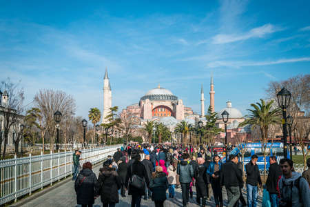 aya sofia: Istanbul, Turkey - January 31, 2016: People are visiting Blue mosque and Hagia Sophia in Istanbul, Turkey Editorial