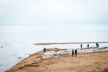 baltic people: Saulkrati, Latvia - February 14, 2016: People are spending Valentines day near the Baltic sea in the winter in Saulkrasti, Latvia