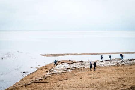 Saulkrati, Latvia - February 14, 2016: People are spending Valentines day near the Baltic sea in the winter in Saulkrasti, Latvia