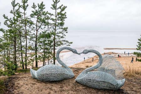 Saulkrati, Latvia - February 14, 2016: People are spending Valentine's day near the Baltic sea in the winter in Saulkrasti, Latvia