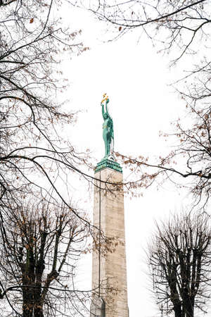 honouring: Riga, Latvia - February 20, 2016: The Freedom Monument is a memorial located in Riga, Latvia, honouring soldiers killed during the Latvian War of Independence 19181920.