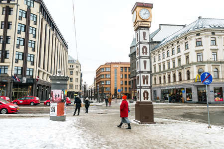one on one meeting: Riga, Latvia - February 20, 2016: People are walking near the Laima clock in downtown Riga. The clock is one of the citys symbols, and a popular meeting place for residents.