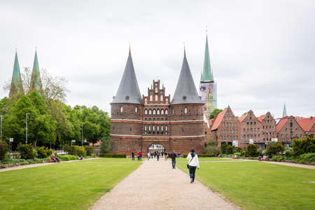 medieval: Lubeck, Germany - May 31, 2015: People are spending time near the Holsten gate of Lubeck in Germany