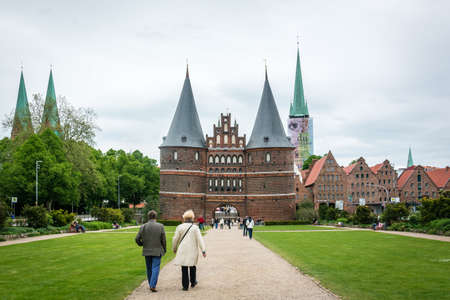 medievales: Lubeck, Germany - May 31, 2015: People are spending time near the Holsten gate of Lubeck in Germany