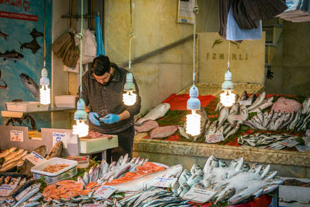 eminonu: Istanbul, Turkey - March 10, 2015: Man is cleaning and selling fishes in the Eminonu, Istanbul