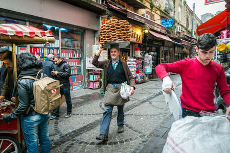 Istanbul, Turkey - March 10, 2015: Men is walking and selling bagels or simit on the market in Istanbul, Turkey