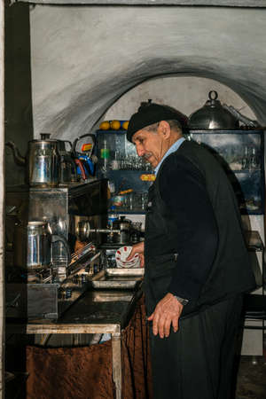 turkish man: Istanbul, Turkey - March 10, 2015: Turkish man is making tea for public outdoor cafe customers in Istanbul, Turkey