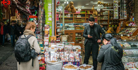 eminonu: Istanbul, Turkey - March 10, 2015: People are shopping on the Market in Eminonu, Istanbul