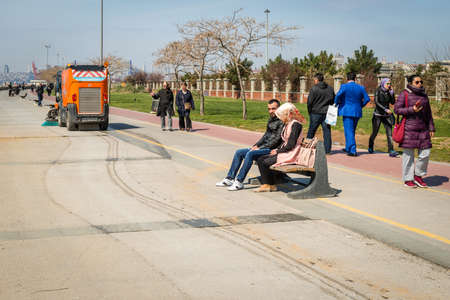 leasure: Istanbul, Turkey - March 29, 2016: People are spending their leasure time on the Kadikoy coastine in Istanbul, Turkey Editorial