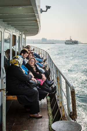 kadikoy: Istanbul, Turkey - April 06, 2016: People are crossing Bosphorus on the Ferry boat in Istanbul, Turkey Editorial