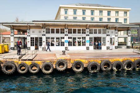 istanbul beach: Istanbul, Turkey - April 06, 2016: People are waiting ferryboat tp arrive in the port of Besiktas in Istanbul, Turkey Editorial