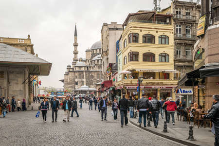 eminonu: Istanbul, Turkey - April 08, 2016: People are walking in the streets of Istanbul in Eminonu district