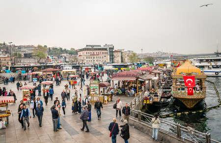 eminonu: Istanbul, Turkey - April 08, 2016: People are walking on the coast of Eminonu where sellers selling turkish fast food  in Istanbul, Turkey