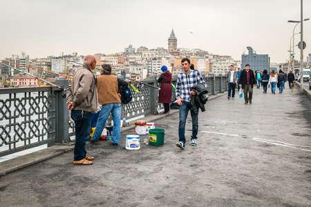 istanbul beach: Istanbul, Turkey - April 08, 2016: People are walking on the Galata bridge in Istanbul, Turkey