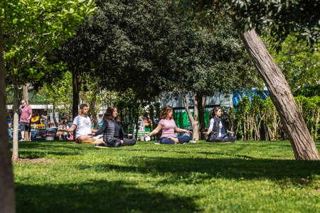 meditates: Istanbul, Turkey - April 17, 2016: Turkish peopel meditates in the Bebek park in Istanbul, Turkey Editorial