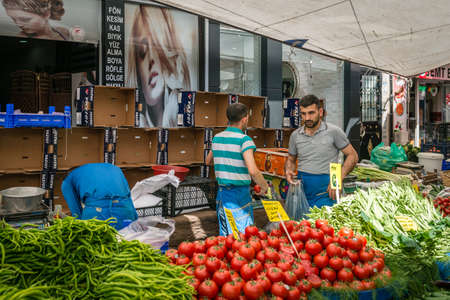 fatih: Istanbul, Turkey - April 20, 2016: Man is selling vegetables in the market in Istanbul, Turkey Editorial