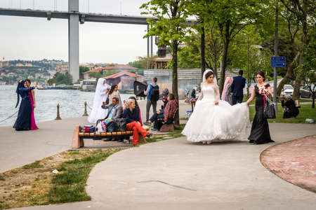 sessions: Istanbul, Turkey - April 23, 2016: Local brides are coming near the Bosphorus for photo sessions in Istanbul, Turkey
