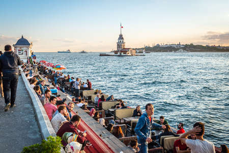leasure: Istanbul, Turkey - April 25, 2016: People are spending leasure time and meeting sunset in Uskudar in Istanbul, Turkey Editorial
