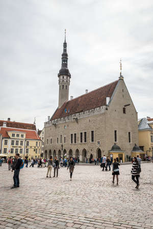 Tallinn, Estonia - July 04, 2016: Local people and tourists are walking  at town hall square in Tallinn, Estonia