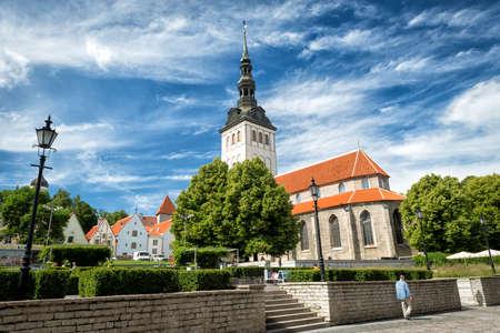 Tallinn, Estonia - July 04, 2016: People are resting in the garden near St. Nicholas Church in Tallinn