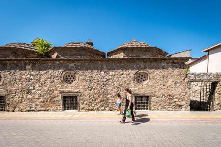 Iznik, Turkey - July 23, 2016: People are walking on the street next to Suleyman Pasa Madrasa (mid 14th century) in Iznik, Turkey Editorial