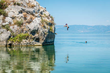 Iznik, Turkey - July 24, 2016: People are jumping from cliff into the lake of Iznik in Turkey Editorial