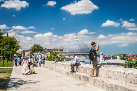 14: Istanbul, Turkey - August 14, 2016: Tourists are visiting Suleymaniye mosque at sunny day in Istanbul, Turkey