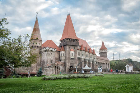 Hunedoara, Romania - September 17, 2016: Tourists visiting Corvin Castle, also known as Hunyadi Castle or Hunedoara Castle which is a Gothic-Renaissance castle in Hunedoara, Romania