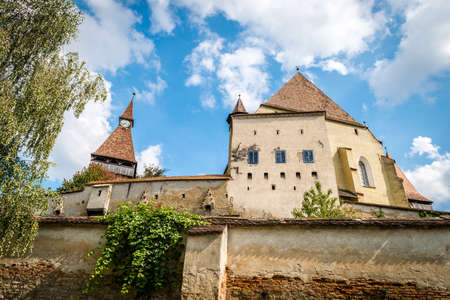 city and county building: Biertan, Romania - September 18, 2016: Saxon village with fortified church in Transylvania. Biertan castle in Romania Editorial