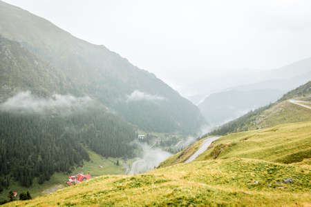 Landscape from Bucegi Mountains, part of Southern Carpathians in Romania in a foggy and rainy day