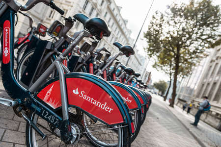 London, United Kingdom - October 17, 2016: Row of Santander Boris Bikes - these are bicycles available to hire by the public, sponsored by Santander Bank in London, UK