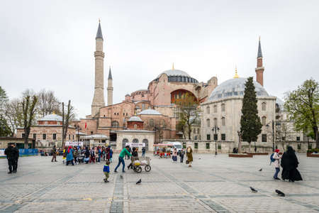 byzantium: Istanbul, Turkey - April 12, 2017: People are visiting Sultanahmet neighborhood of Fatih, Istanbul near the Hagia Sophia Museum which is one of the most popular tourist attractions in Istanbul.