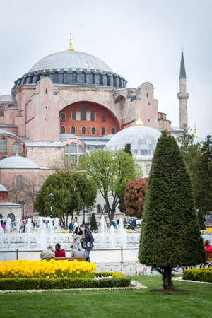 Istanbul, Turkey - April 12, 2017: People are visiting Sultanahmet square near the Hagia Sophia Museum during the Istanbul Tulip festival in April.