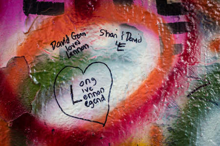 Prague, Czech Republic- July 15, 2017: The John Lennon Wall in 1980s was a symbol of resistance against comunist government, but today it is covered with love quotes and tourist messages to Prague as a symbol of peace and love. Prague, Czech Republic.