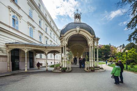 Karlovy Vary, Czech Republic- September 23, 2017: People are visiting Park Colonnade in the Dvorak Park in Karlovy Vary, Czech Republic