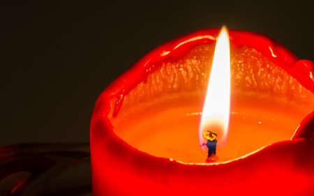 Macro of burning candle isolated on dark background Stock Photo