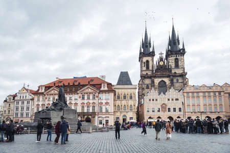 Prague, Czech Republic- November 12, 2017: Tourists are visiting Prague Old Town Square in a winter, Czech Republic
