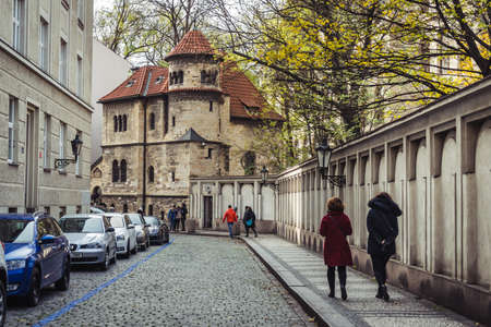 Prague, Czech Republic- November 12, 2017: People are walking towards The Klausen Synagogue whıch is the largest synagogue in the former Prague Jewish ghetto and a single example of an early Baroque synagogue in the area.
