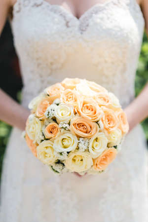 Wedding details and traditions. Bridal bouquet from beautiful salmon colour roses