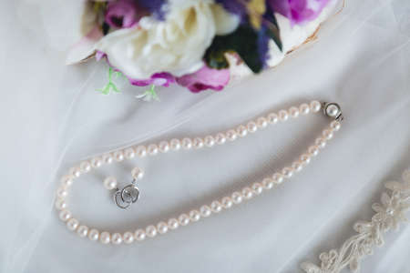 White pearl jewlery close up photography. Wedding details and traditions Stock Photo