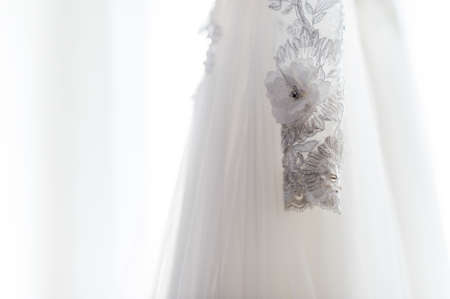 Wedding detail photography. Beautiful white wedding dress. Bridal morning