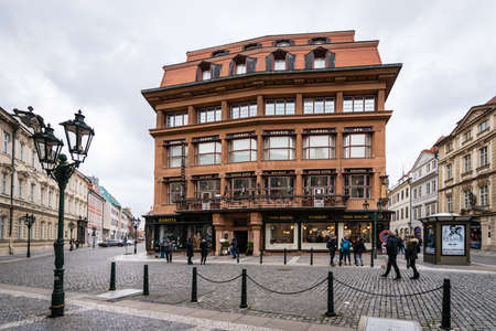 Prague, Czech Republic- February 18, 2018: People are walking on the streat near the House of the Black Madonna which is a cubist building in the Old Town area of Prague, Czech Republic