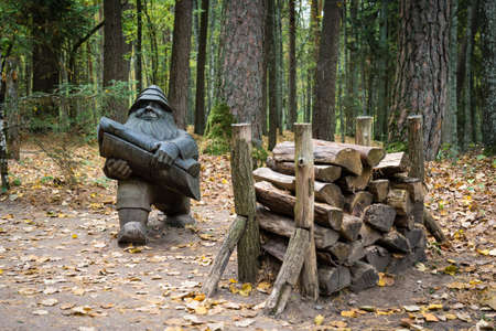 Tervete, Latvia- October 07, 2018: Wooden statue of gnome in the amusement park in forest of Tervete. Publikacyjne