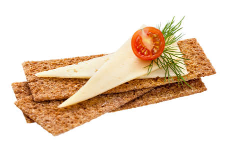 Crispbread with cheese, tomato and dill isolated on white  Healthy breakfast