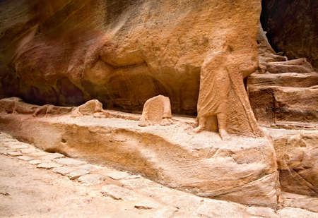 caved: Remains of ancient statues in the Siq in Petra, Jordan