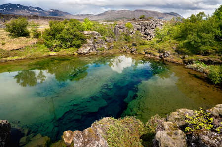 Deep fissure in the lake at Thingvellir National Park, Iceland Stock Photo