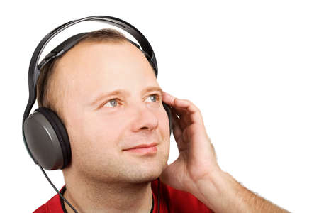 hand jamming: Young man listening to the music in headphones isolated on white Stock Photo