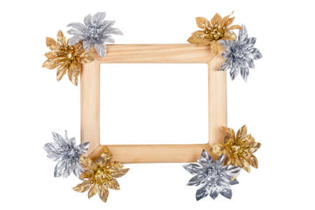 Wooden photo frame decorated with golden and silver flowers isolated on white photo